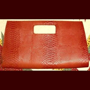 Orange clutch. Never used!
